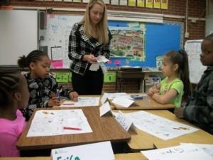 Junior Achievement volunteer at work in the classroom.